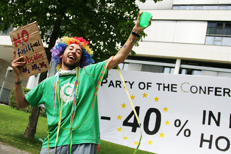 A young climate activist demands an end to fossil fuel subsidies during a spoof party to celebrate 40% carbon <br />emissions reduction targets outside the Bonn climate talks. Photo for Young Friends of the Earth Europe. <br />GERMANY, Bonn | 2011