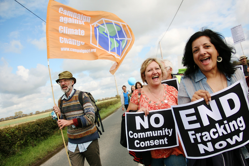 Climate campaigners on Camp Frack march to oppose Britain's first hydraulic fracturing shale gas well. <br />Photo for Campaign against Climate Change. <br />UNITED KINGDOM, Southport | 2011