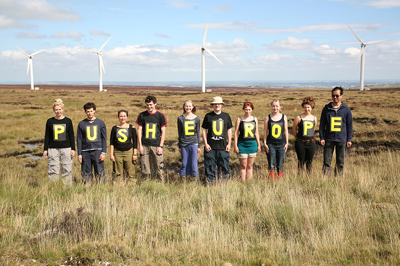 From the Ovenden Moor Wind Farm, young people call on Europe to commit to the reductions in CO2 that scientists say <br />are needed to keep our planet safe from dangerous climate change. Photo for Young Friends of the Earth and Push Europe. <br />UNITED KINGDOM, Yorkshire, Ogden Moor | 2011