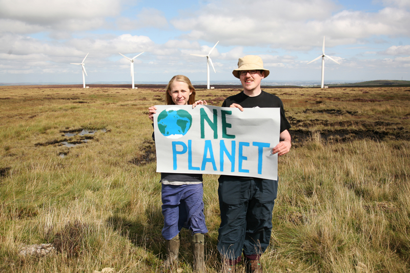 "From the Ovenden Moor Wind Farm, Young Friends of the Earth ""Push Europe"" to commit to the <br /> reductions in CO2 that scientists say are needed to keep our planet safe from dangerous climate change.<br />UNITED KINGDOM, Yorkshire, Ogden Moor 