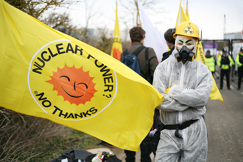 Masked protester at Hinkley Point nuclear power station where hundreds gathered to mark the <br />first anniversary of the Fukushima disaster and to call for a halt to the development of Hinkley C.<br />UNITED KINGDOM, Bridgwater | 2012