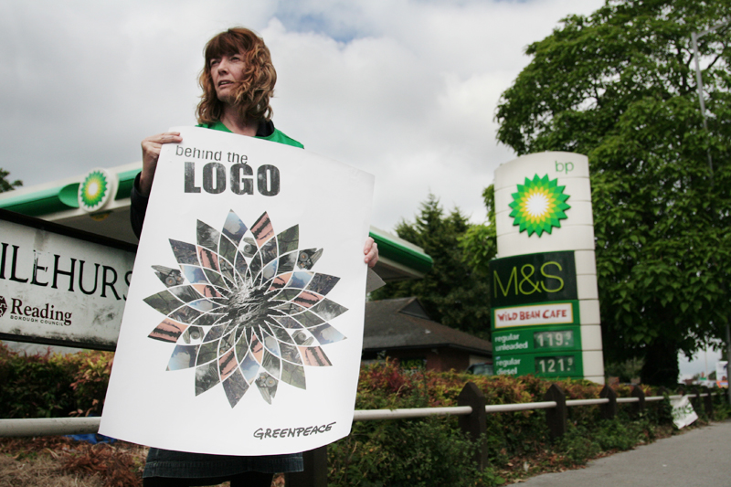 "Berkshire Greenpeace activist reveals the pollution behind BP's logo, a company that, after rebranding <br />itself as ""Beyond Petroleum"", plans to invest in tar sands, the dirtiest oil currently being produced.<br />UNITED KINGDOM, Reading 