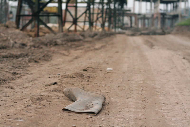 Wellington boot abandoned on derelict industrial site.<br />ROMANIA, Resita | 2008